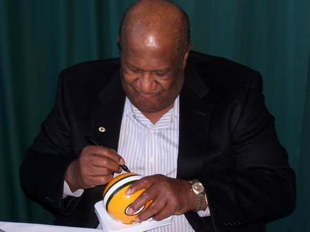 Willie Davis signing mini helmet.JPG